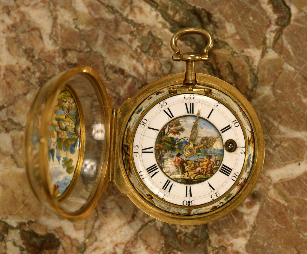 A gold, enamel and rock crystal pair cased watch.