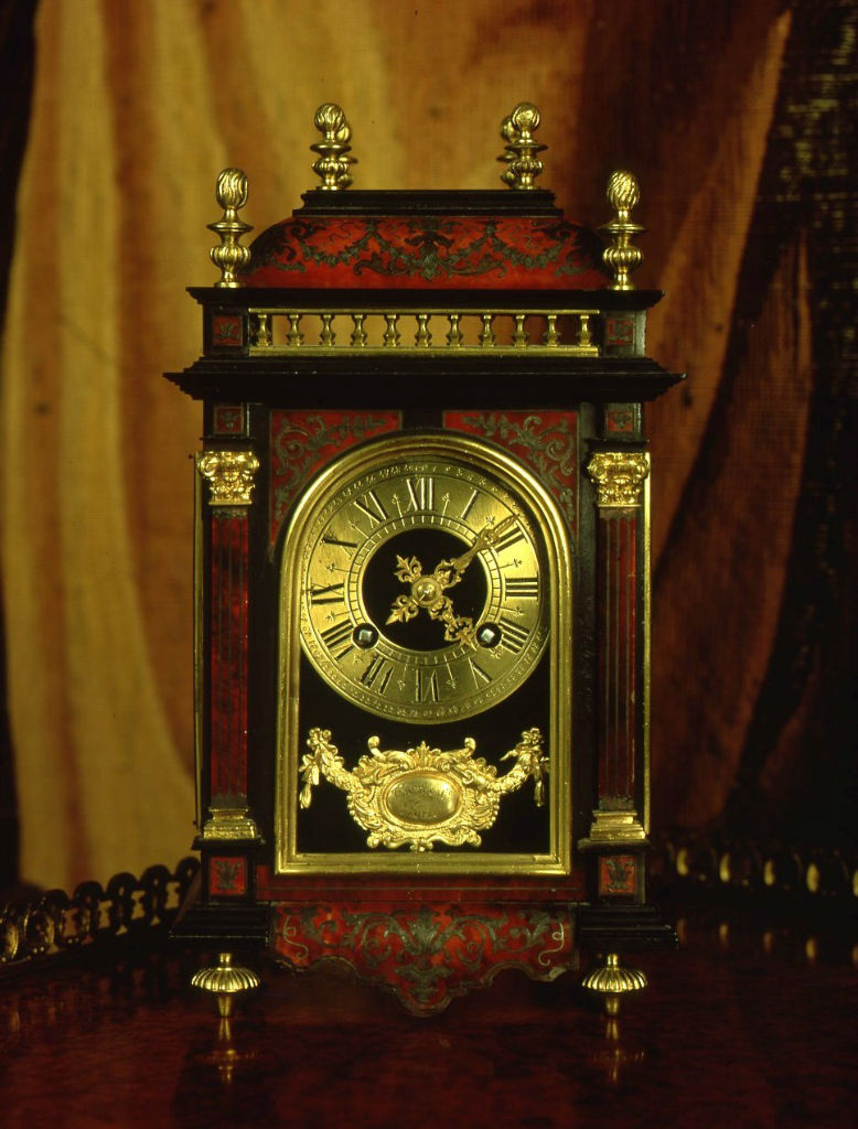 A small French red boulle mantel clock, circa 1875.