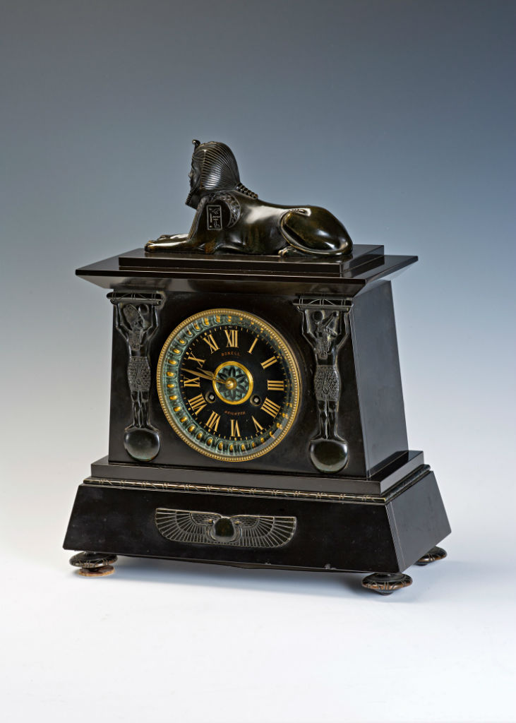 A late 19th Century French Egyptian-Revival bronze and black marble mantel clock.