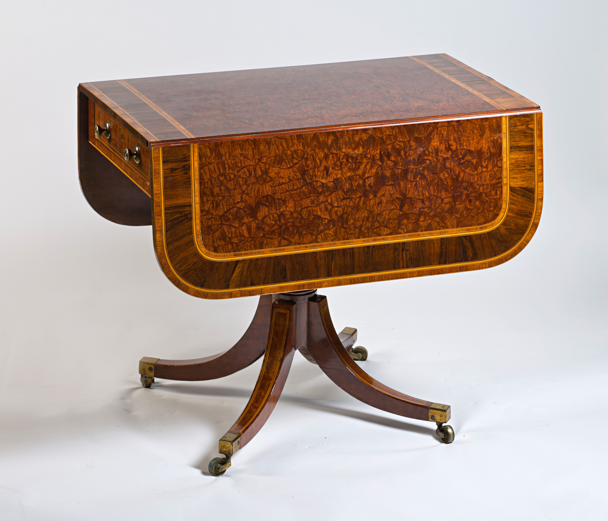 A George III crocodile mahogany Pembroke table, circa 1800.