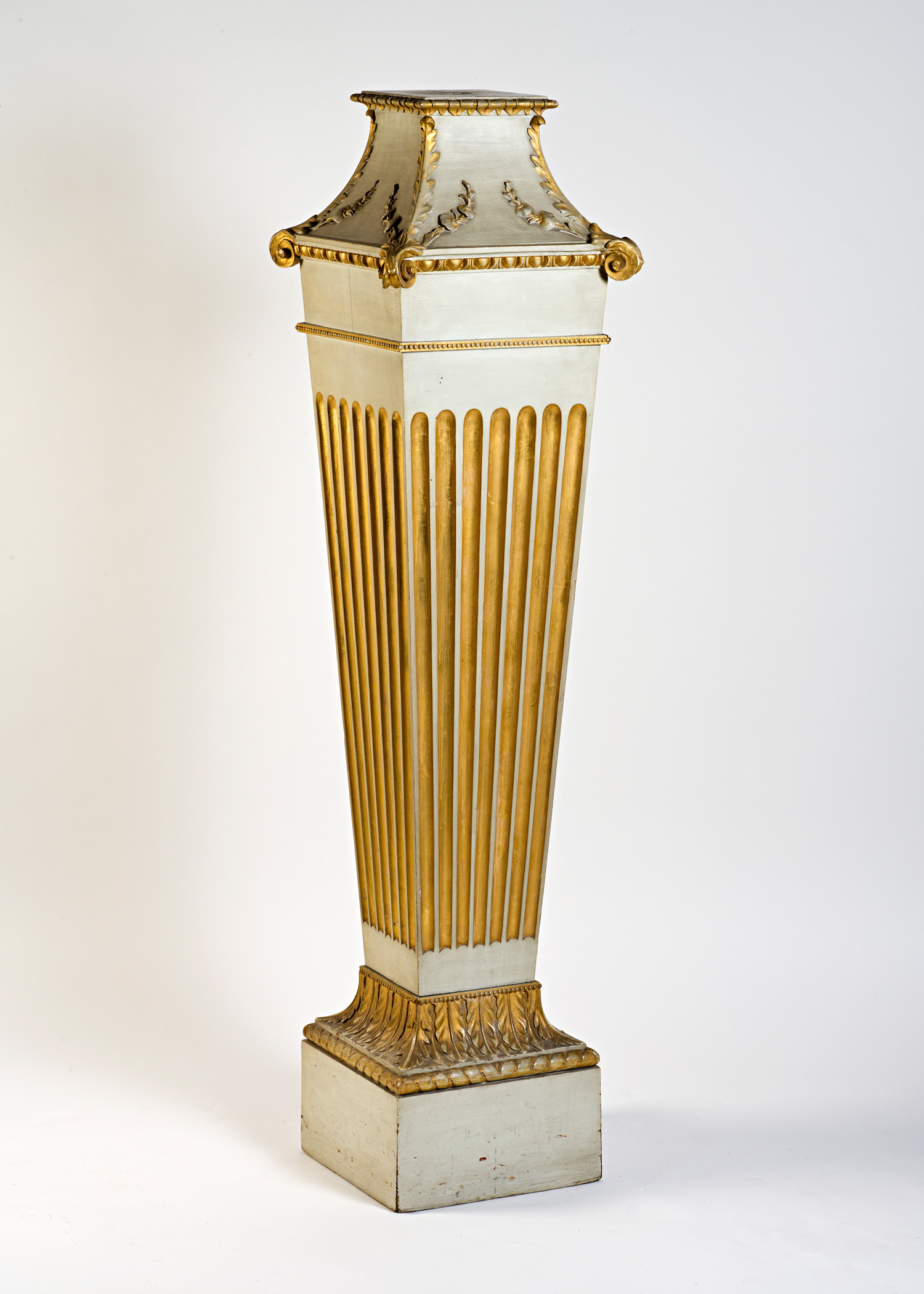 A pair of George III style white-painted and parcel-gilt columns, circa 1900.