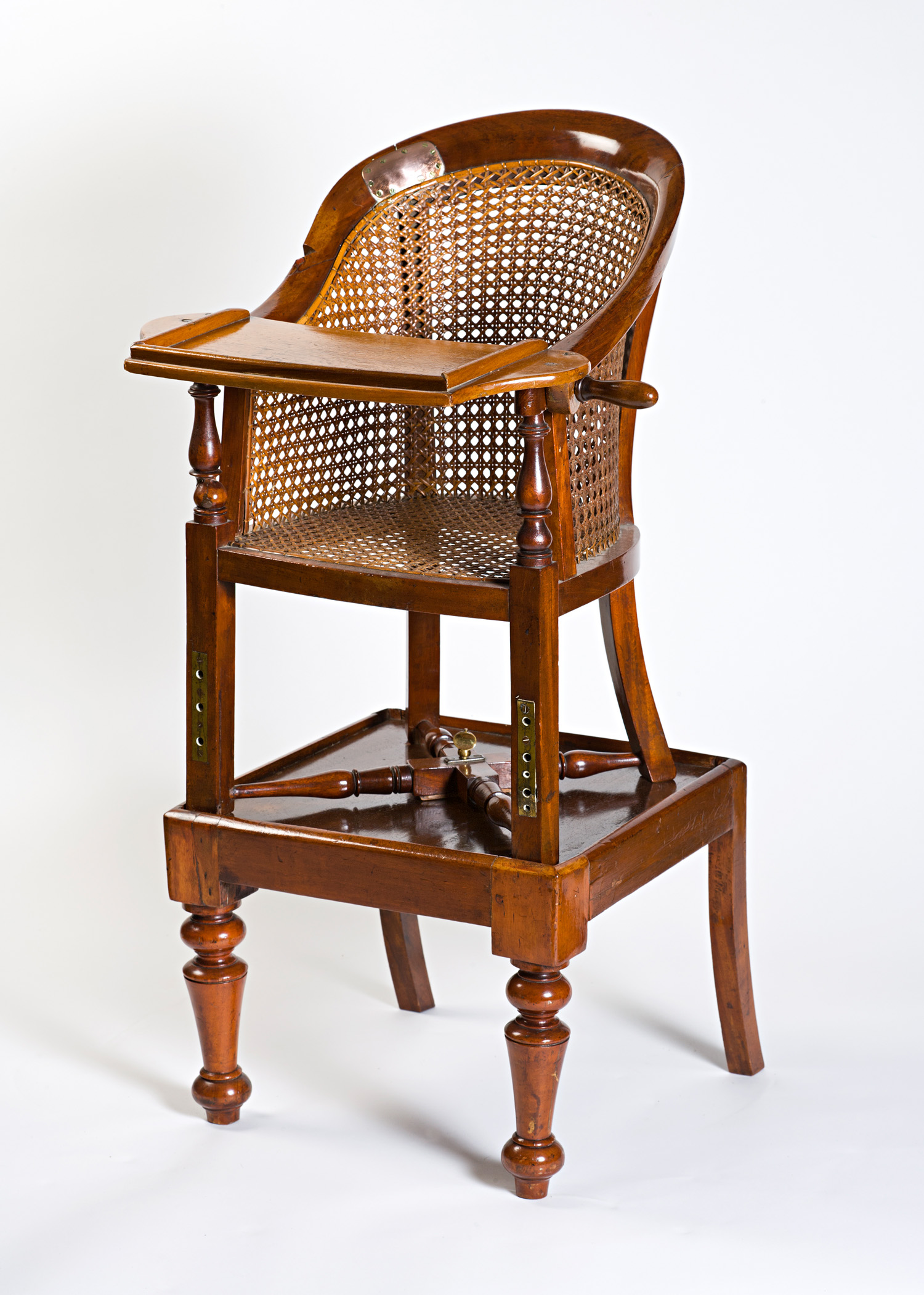 An early Victorian mahogany child's bergère, circa 1840.