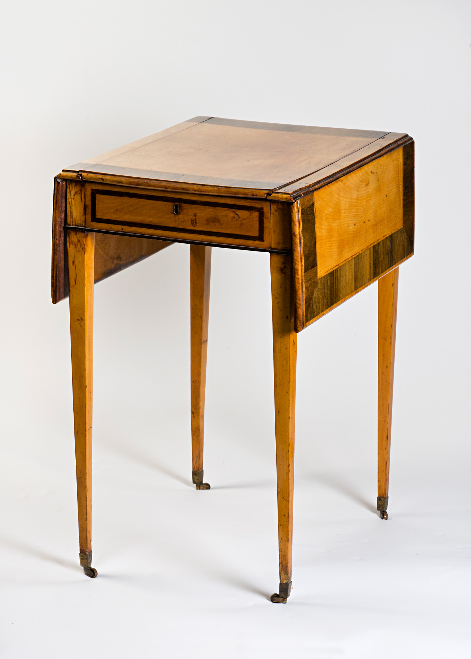 A George III satinwood writing and work table, circa 1795.
