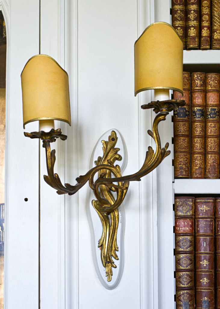 A set of five Louis XV style twin-branch gilt bronze wall lights, circa 1900.