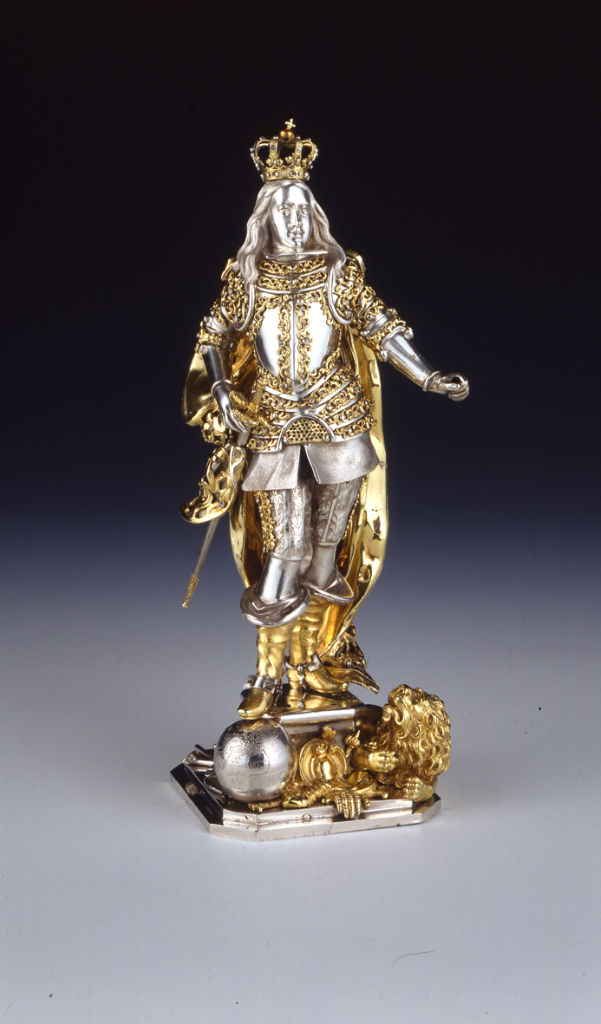A parcel-gilt figure of a King wearing armour, possibly German, second half of the 17th Century.