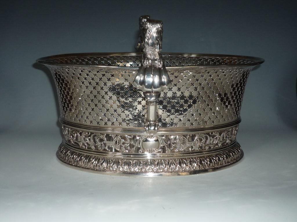 A large George II oval cake basket, John Edwards, London, 1731.