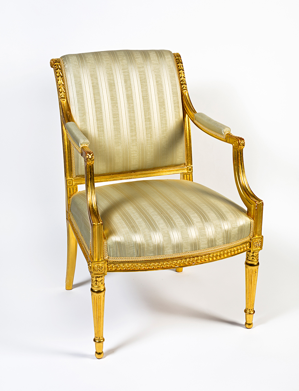 A set of gilt-mahogany seat furniture, comprising a sofa and ten armchairs, George III, circa 1780.