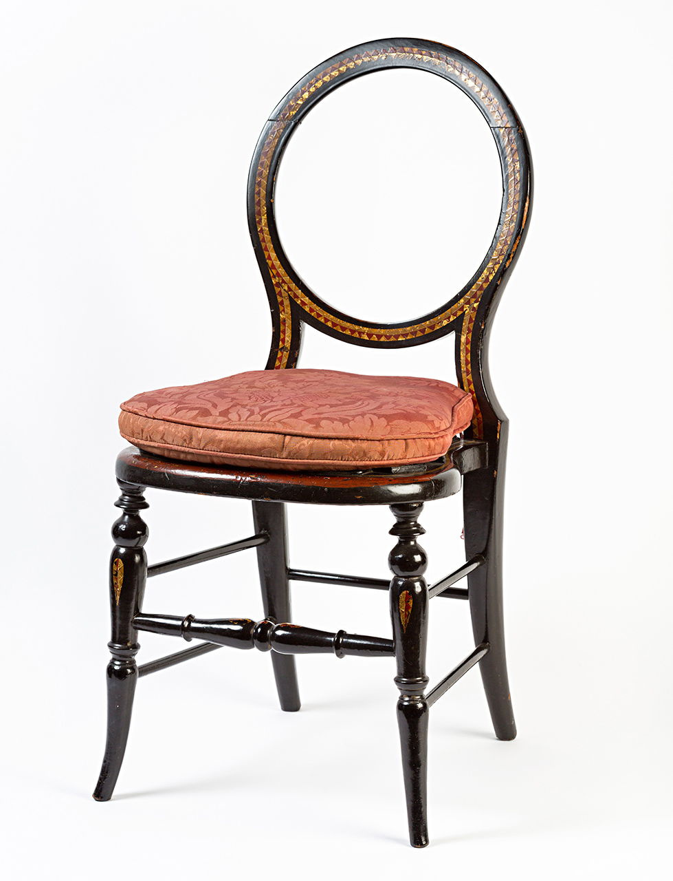 A pair of Victorian black and gilt papier-mâché child's side chairs, circa 1850.