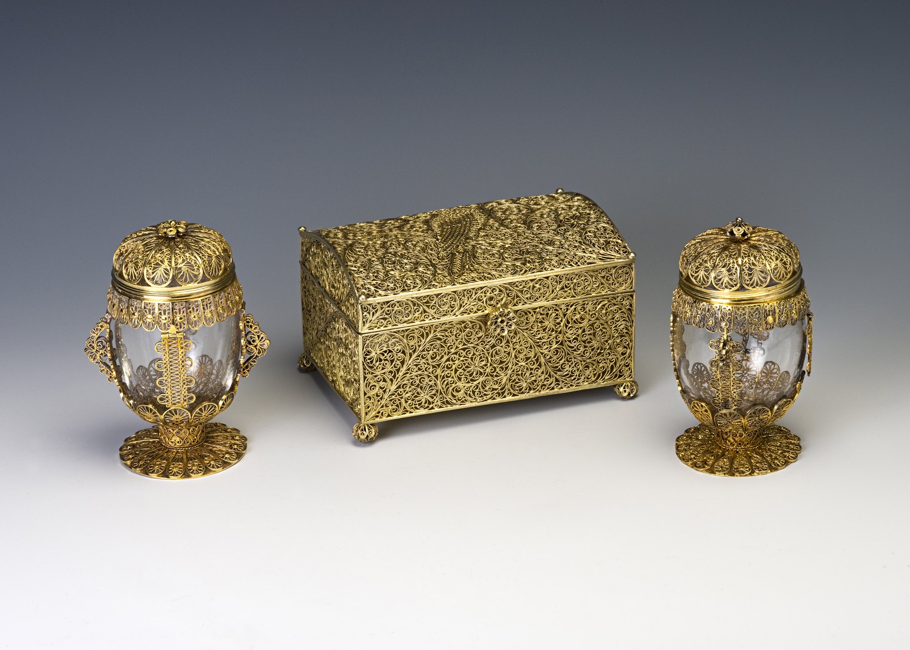 A part silver-gilt filigree toilet set, circa 1700.