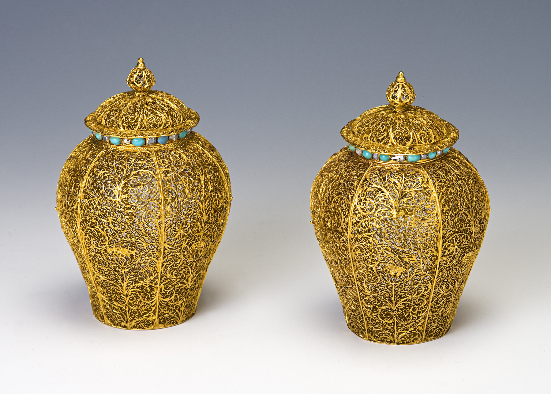 A pair of gold filigree baluster vases and covers, late 17th Century.