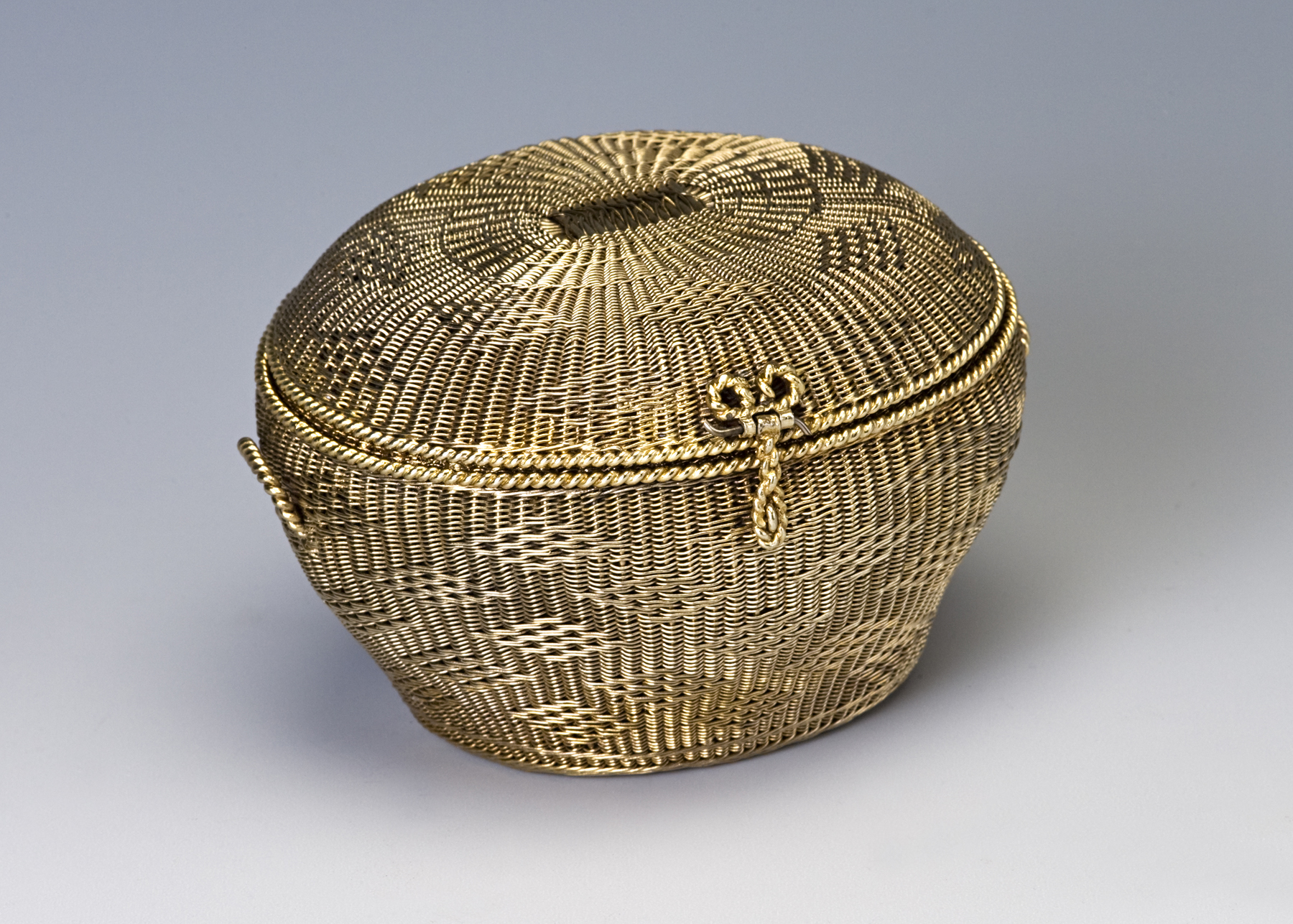 A small silver-gilt basket-weave casket.
