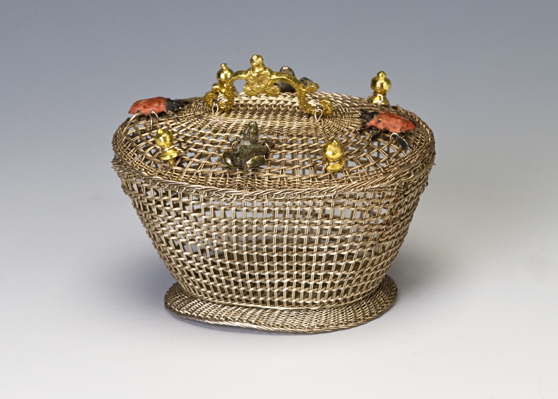 A silver basket-weave basket, German, late 17th Century.