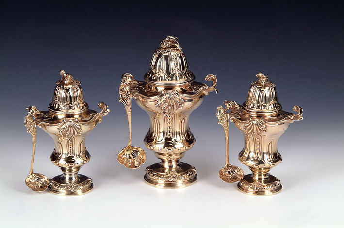 A set of three George II silver-gilt sugar vases and covers, Edward Wakelin, London, 1753.