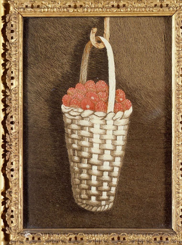 A naive woolwork of a basket of strawberries, English, late 18th Century.