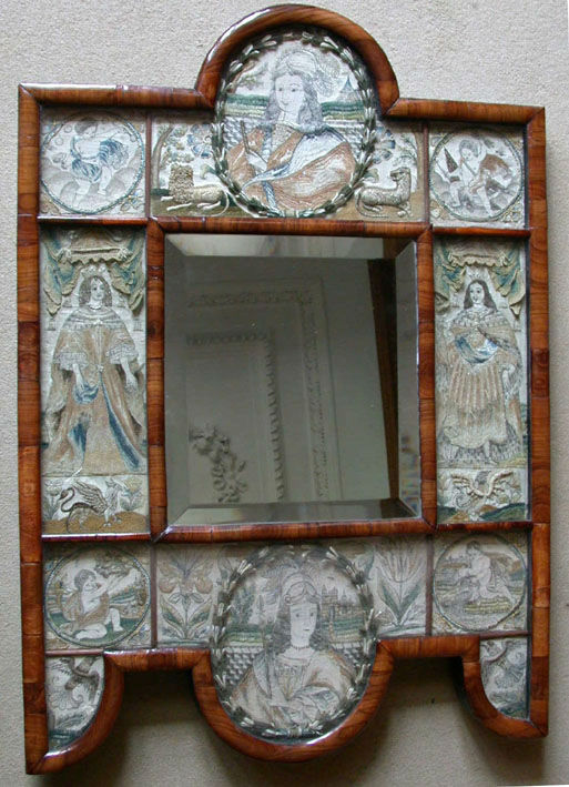 A Charles II embroidered mirror surround, English, circa 1660.