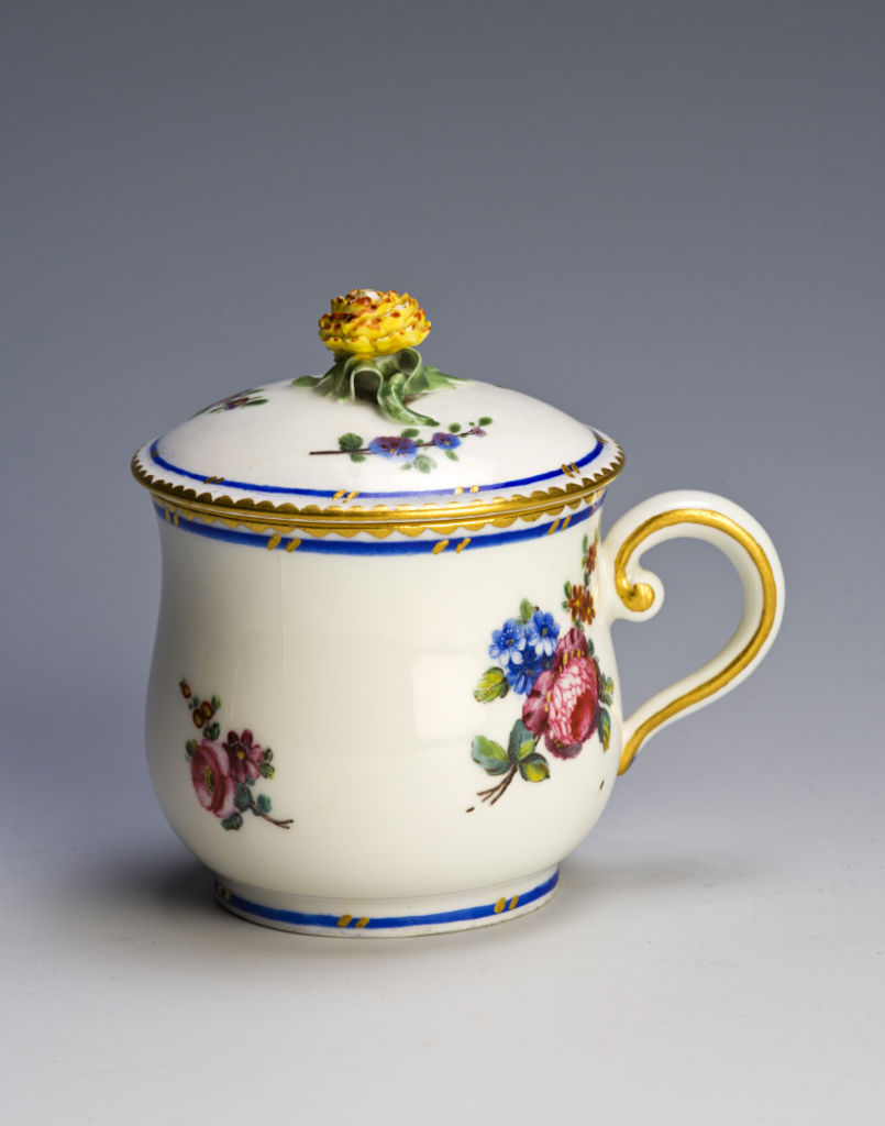A Sèvres custard cup and cover, dated 1766.
