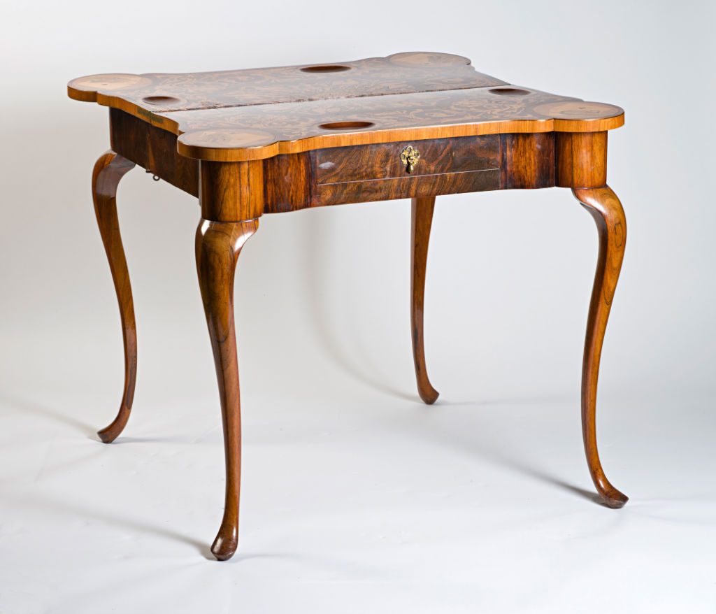 A pair of Dutch rosewood and walnut marquetry concertina-action card tables, circa 1750, the tops circa 1830.