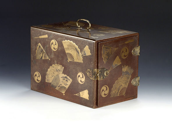 A cabinet, decorated with fans and tomoe crests, late 18th Century.