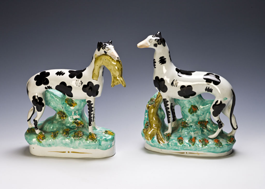 A pair of Staffordshire figures of greyhounds, circa 1850.