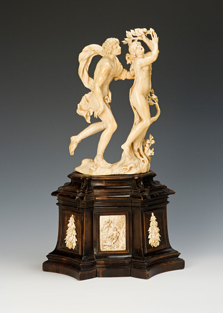 An ivory group of Apollo and Daphne, North Italian (probably by an expatriate German craftsman), late 17th Century, after Bernini, on an ebonised base.
