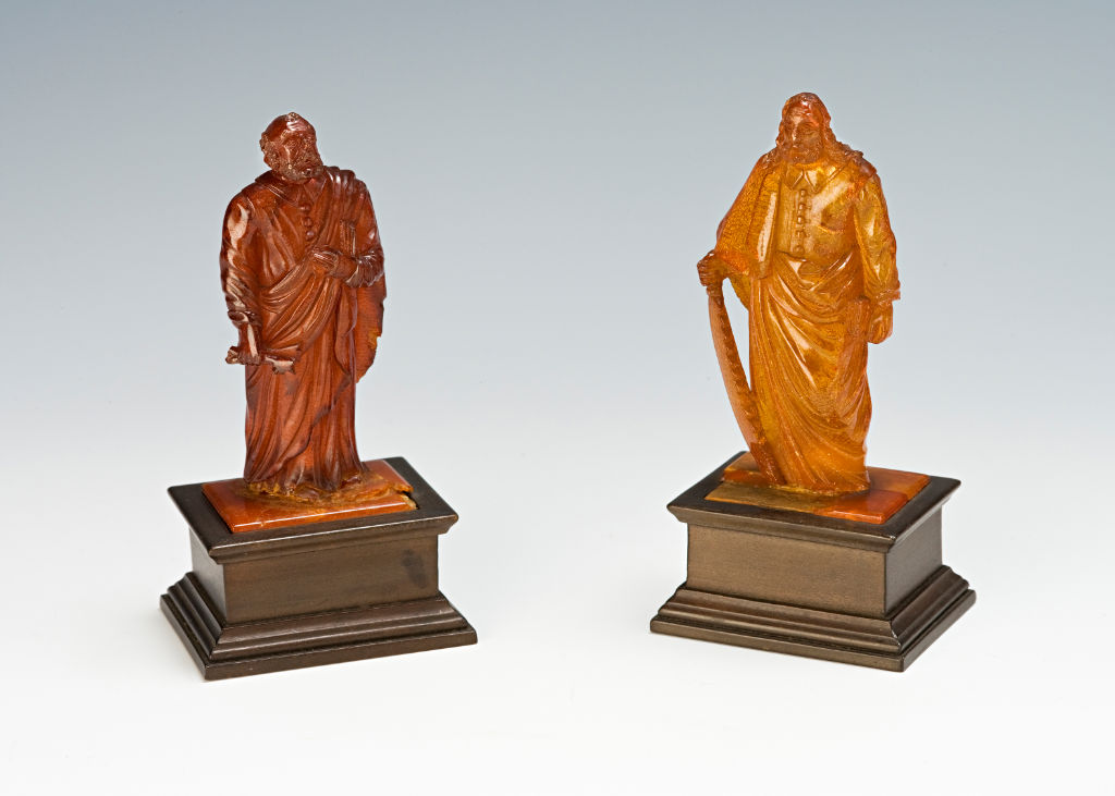 Two amber figures of the Apostles St. Peter and St. Simon the Zealot, North German, circa 1695.