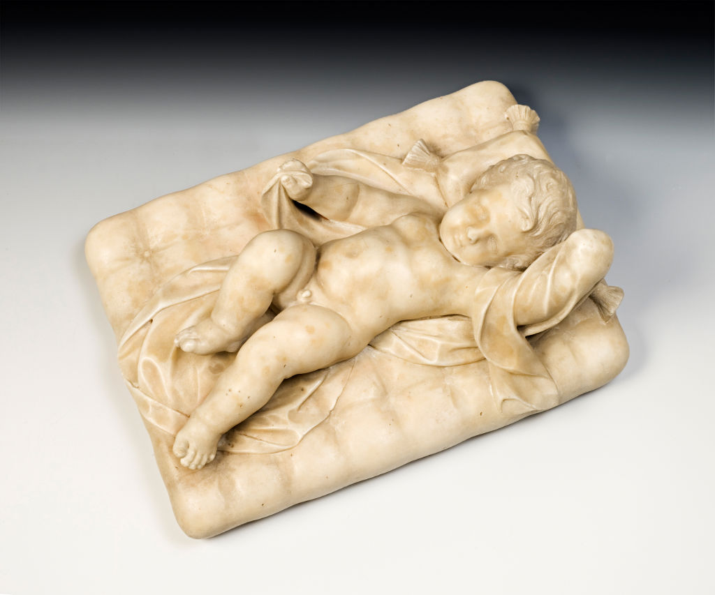 A Roman white marble figure of a sleeping child, attributed to Pierre Étienne Monnot, late 17th Century.