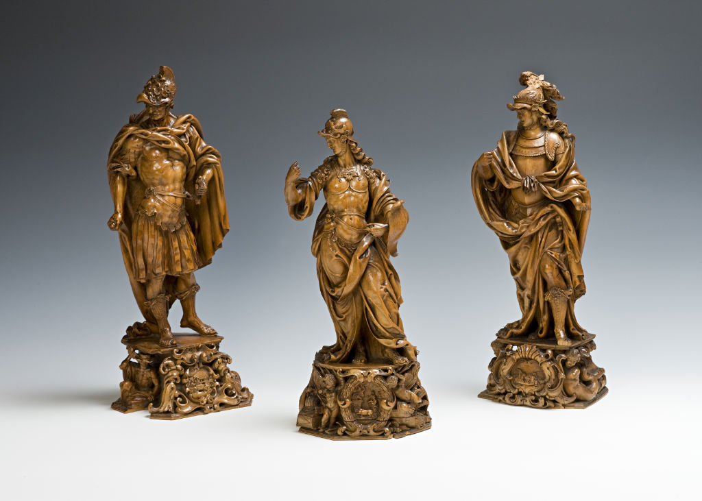 Three figures, intricately carved in boxwood, Italian, possibly by an expatriate German craftsman, late 17th Century.