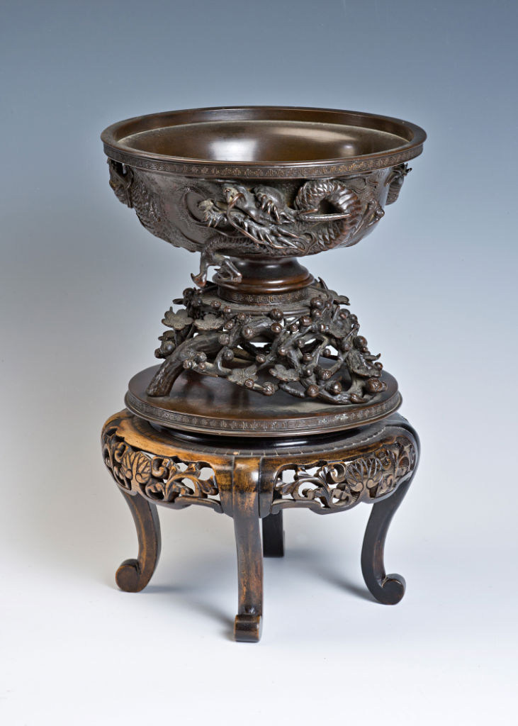 A Japanese bronze bowl, (koro), with accompanying base.