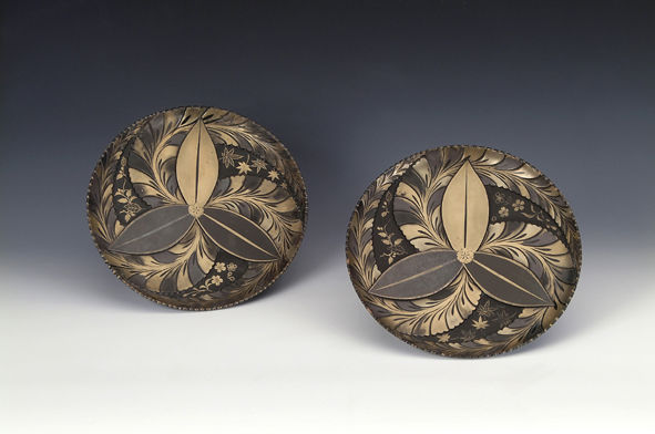 A pair of carved and lacquered dishes, 17th Century.