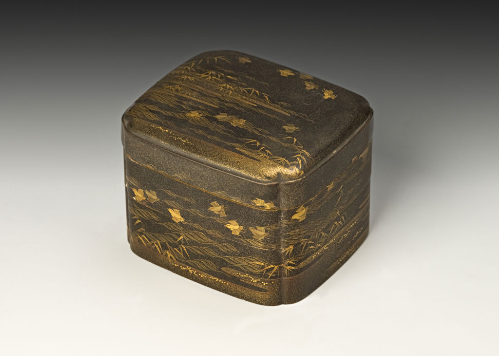 A two-tiered box and cover, 18th Century.