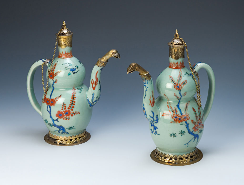 A pair of celadon-glazed double gourd ewers, circa 1660/1680.