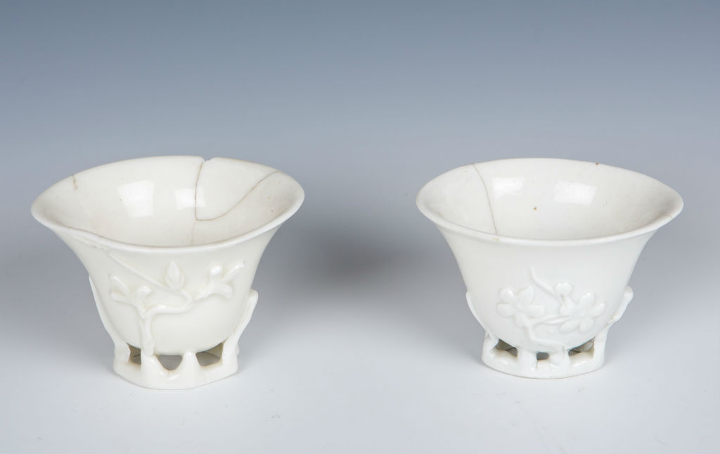 A pair of blanc de chine wine cups, early Kangxi.