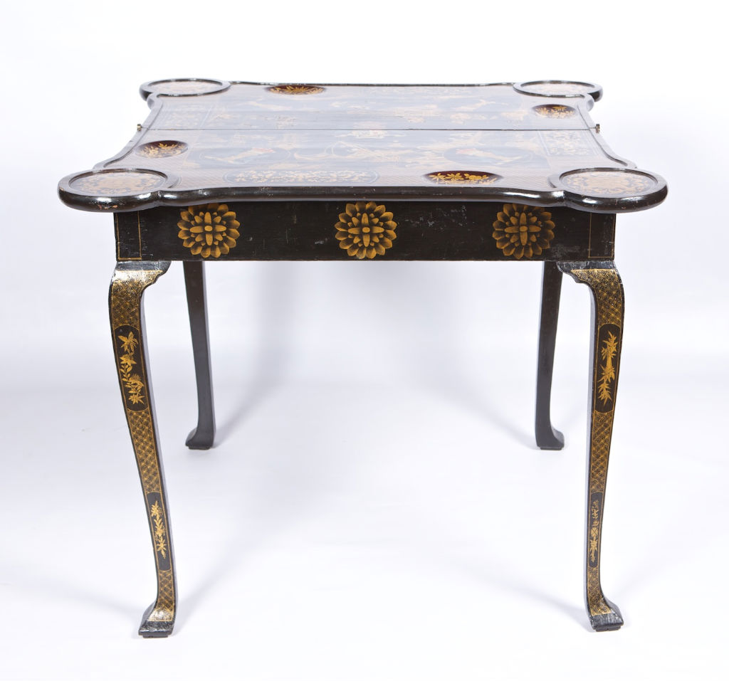 A Queen Anne black japanned card table, circa 1710.