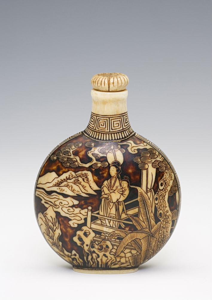 An ivory and dark brown lacquer snuff bottle, Japanese, 1750-1795.