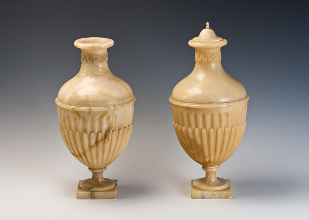 A pair of alabaster gadrooned urns, late 18th Century.