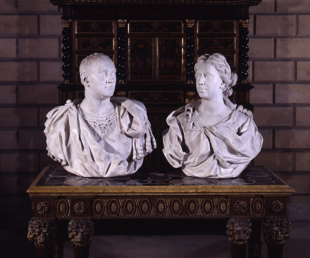A pair of Roman white marble busts, by Pierre-Etienne Monnot, signed P.S. Monnot.f.Rom.1701.