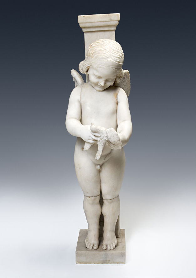 A white marble figure of Cupid holding a dove, partly Ancient, the rest 17th/18th Century.