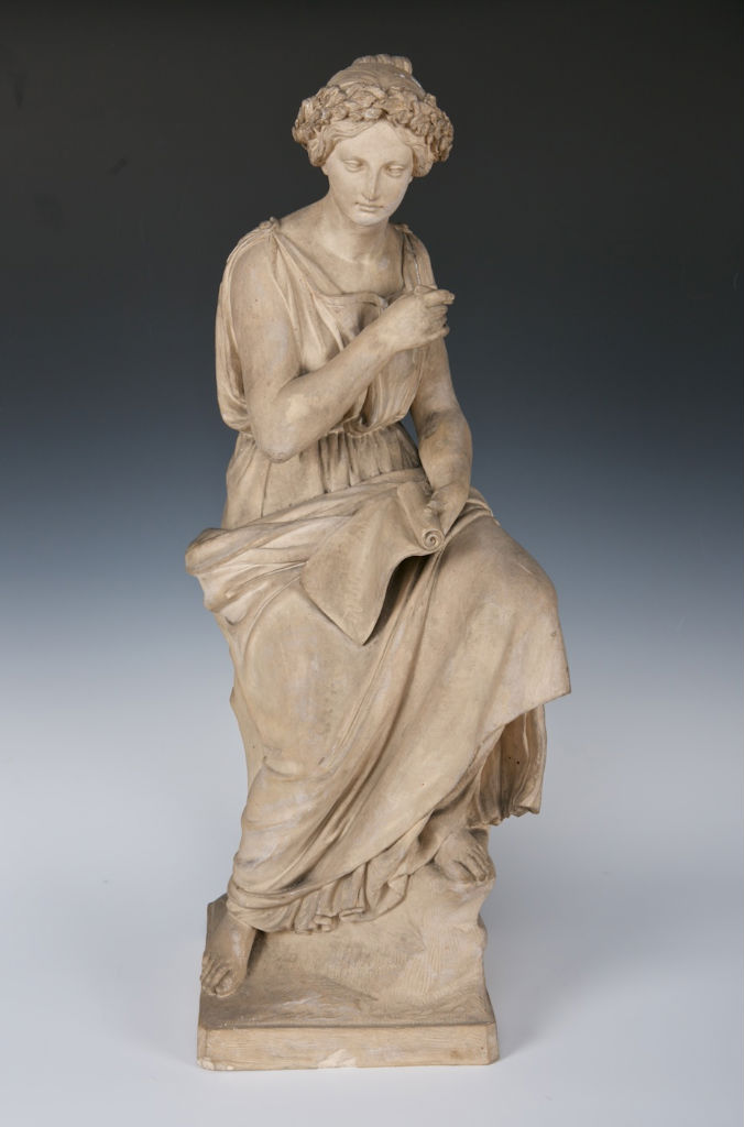A terracotta figure allegorical of 'Literature'.
