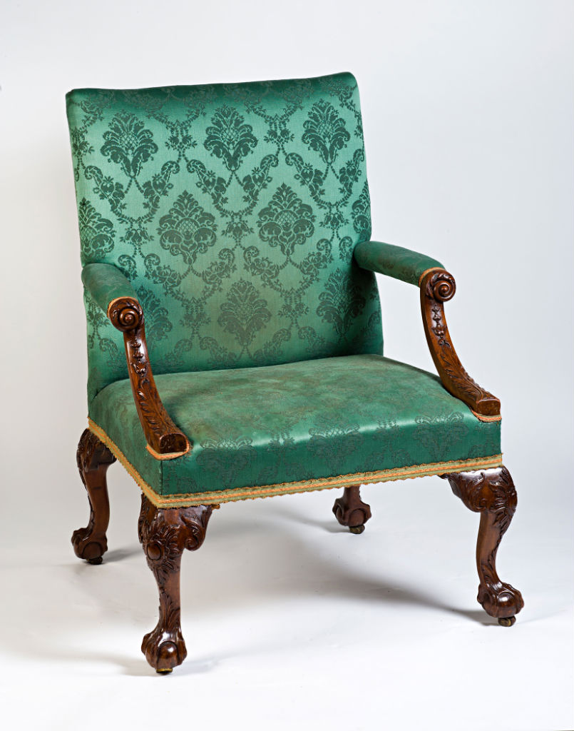 A set of  twenty eight George II mahogany library armchairs, circa 1745.