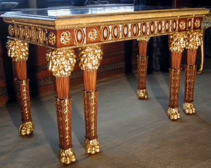A pair of George III mahogany and parcel-gilt pier tables, circa 1775.