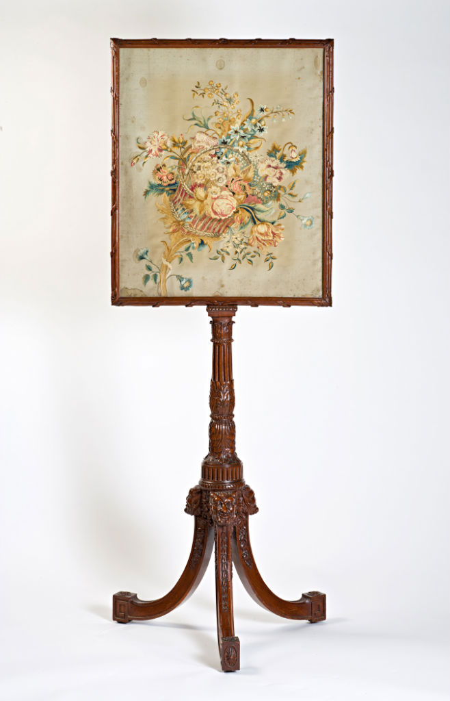 A George III mahogany pole-screen, circa 1770.