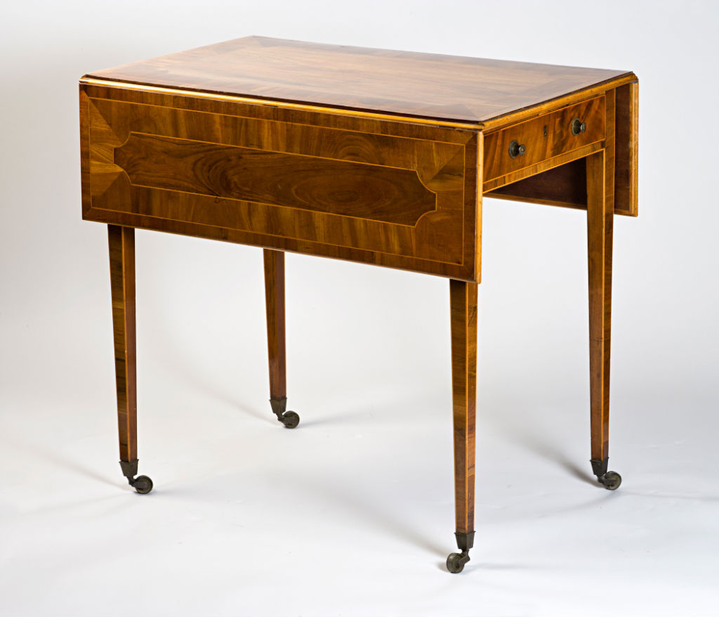 A George III rosewood and mahogany banded Pembroke table, circa 1790.