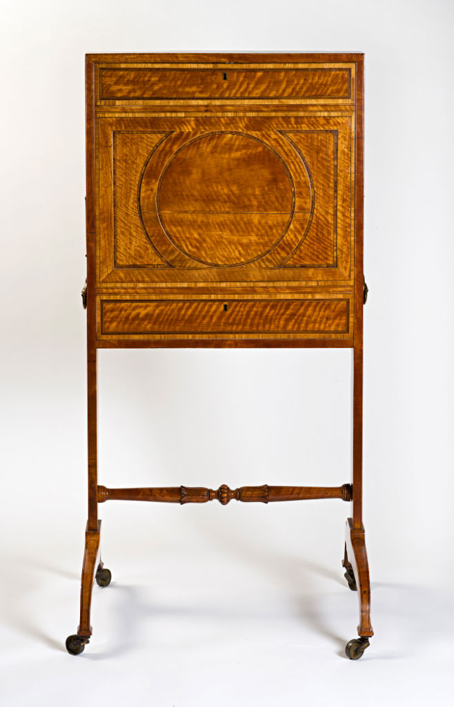 A George III satinwood lady's writing screen, circa 1785.