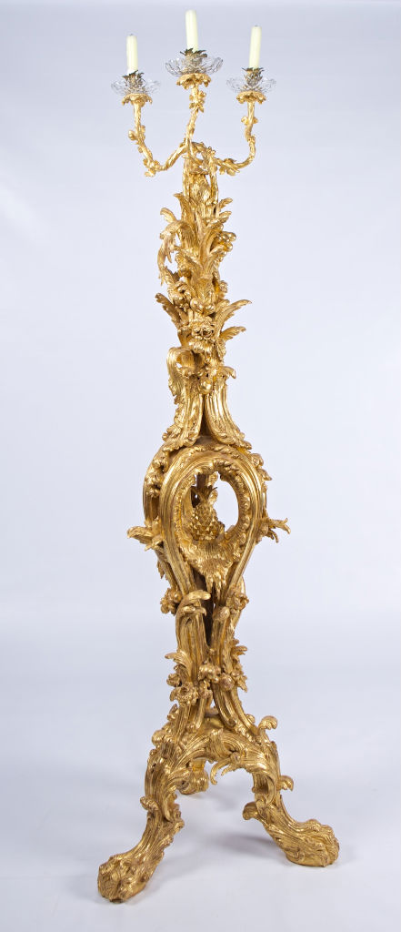 A set of three carved giltwood torcheres, circa 1760, by Mayhew & Ince.
