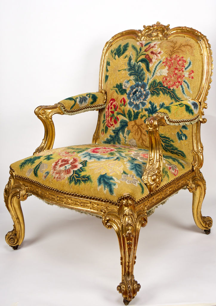 A set of twelve George III giltwood salon chairs, in the manner of Mayhew & Ince, circa 1760.