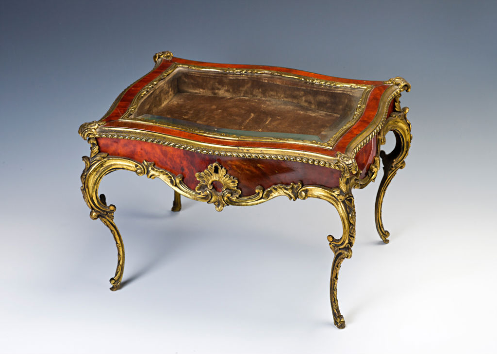 A gilt-brass mounted red-stained tortoiseshell miniature table virtrine, circa 1860.