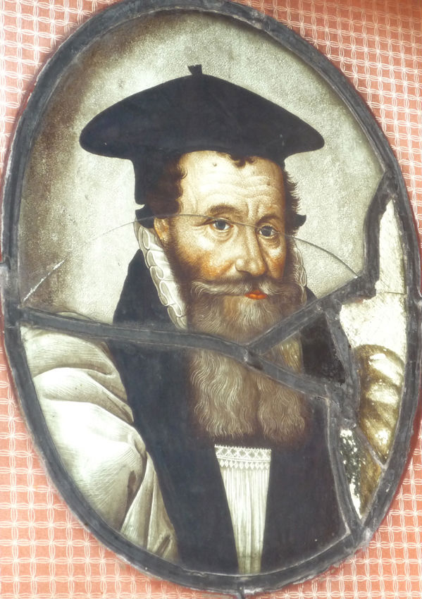 An oval stained glass portrait of Archbishop Richard Bancroft, early 17th Century.