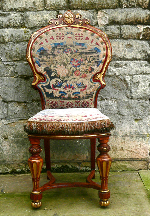 A Victorian oak and parcel-gilt chair, circa 1850.