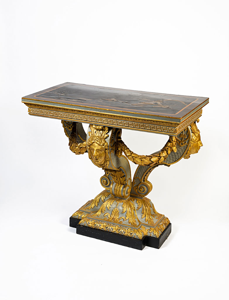A George II lacquer painted and parcel-gilt console table, in the manner of William Kent, circa 1730.