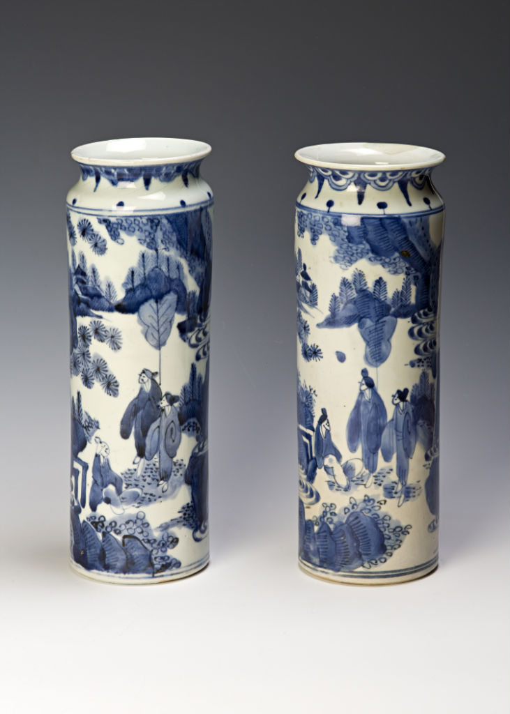 A pair of Arita blue and white sleeve vases or rollwagons, circa 1660-80.
